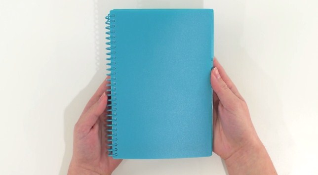 customizing a plain notebook with Cricut vinyl