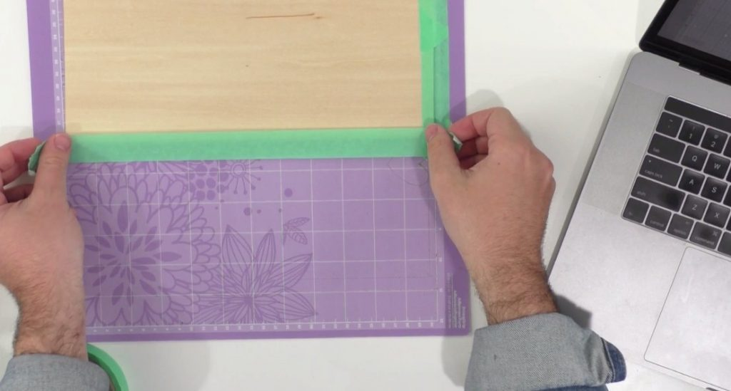 Tape the wood down well when cutting with Cricut.