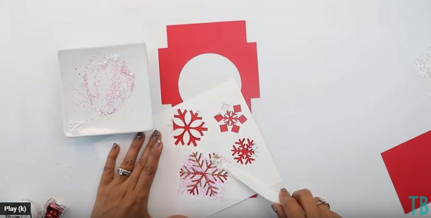 Use A Spatula To Spread The Glitter Glue On The Stencil