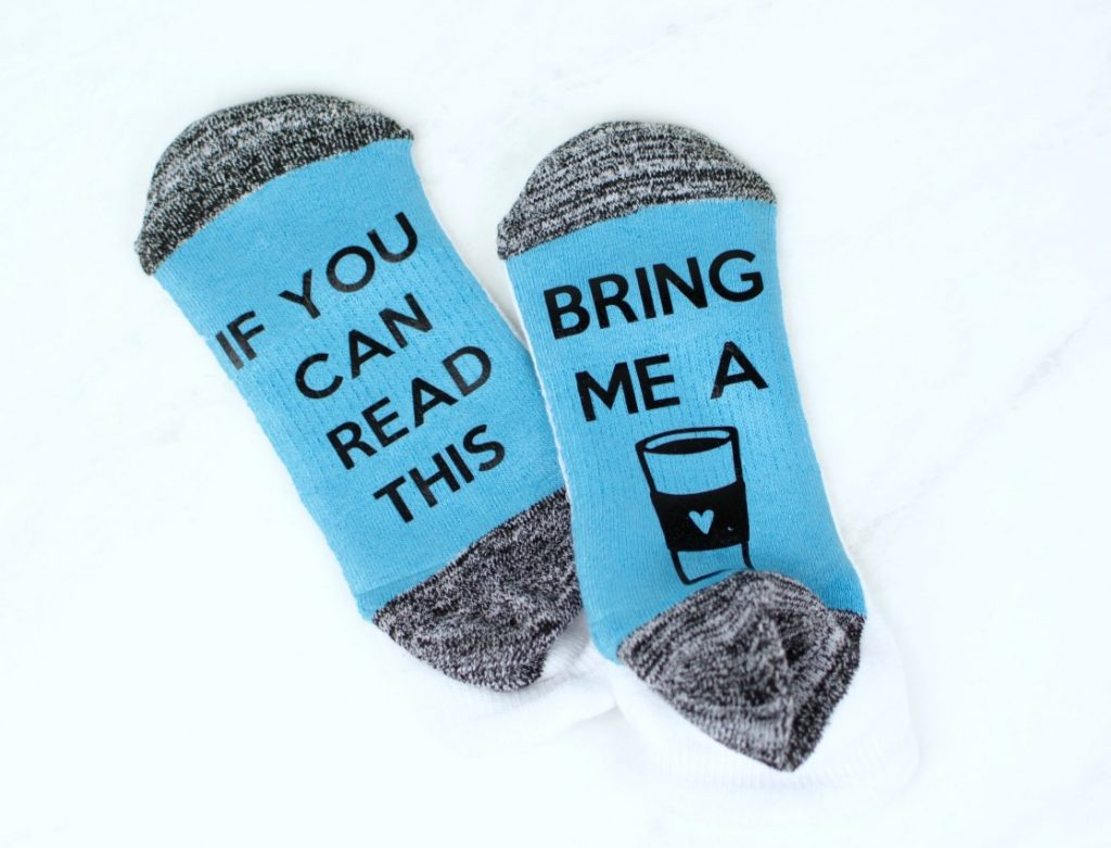 Socks with text saying If you can read this on one and bring me a with a picture of a coffee on the other