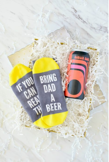 Socks. On the bottom they say If you can read this bring dad a beer