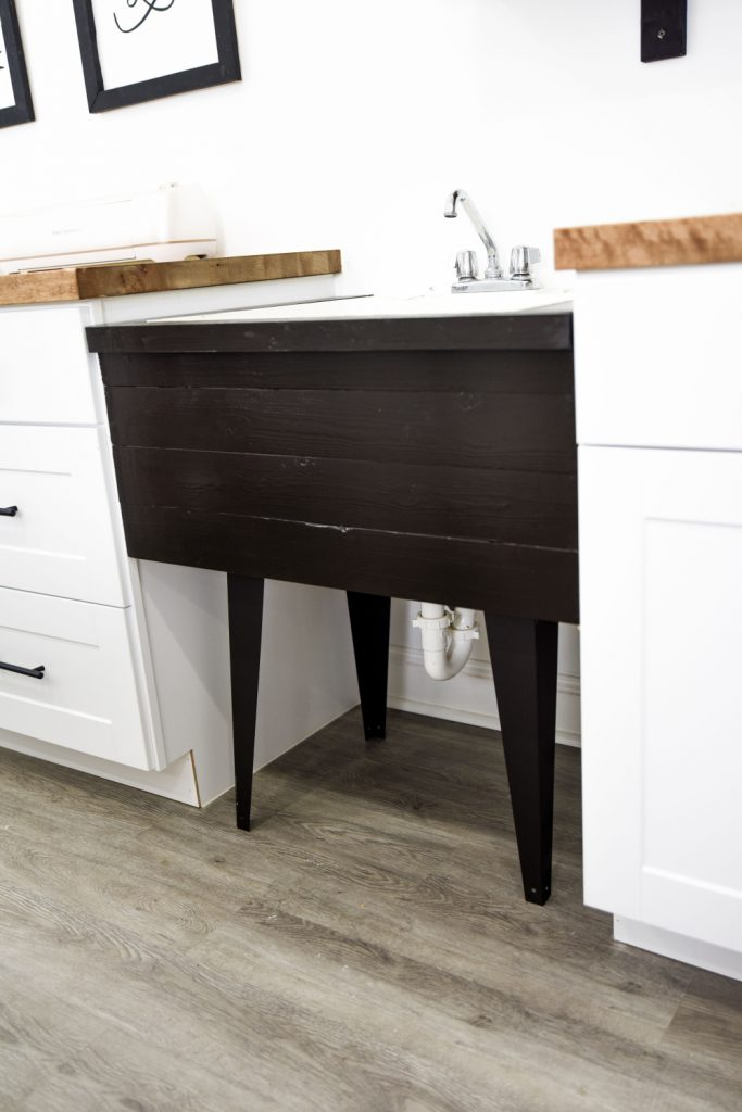 adding style to a basic utility sink by attaching 1 by 4's to the front