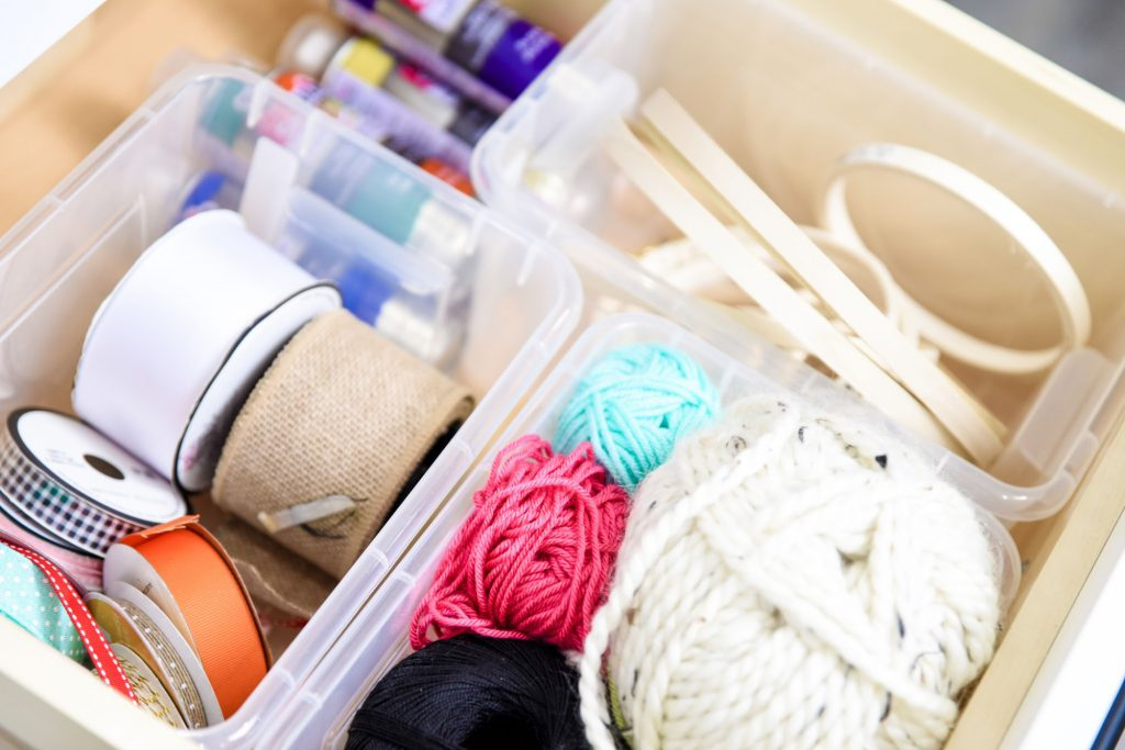 Using Plastic Containers In Drawers To Hold Craft Supplies