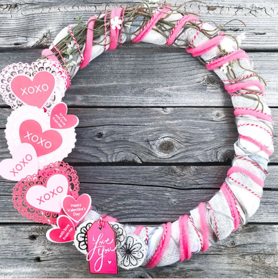 Diy Valentines Wreath with Cricut Print then Cut hearts and tags saying XOXO and I Love You