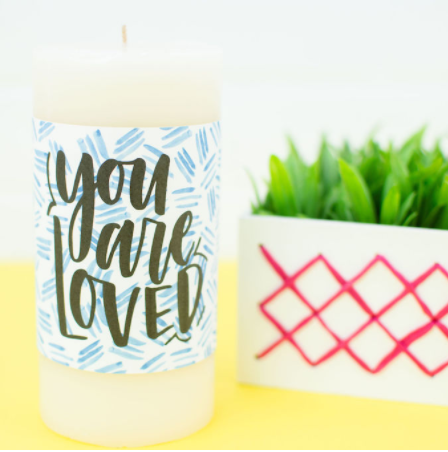 Print Then Cut Valentines Day Candle Wrap Made with Cricut Saying You are Loved with Blue Random Line Design Behind Words