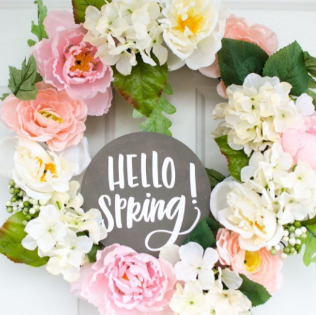 Flower Spring Wreath Plaque with a text in the middle that says Hello Spring!