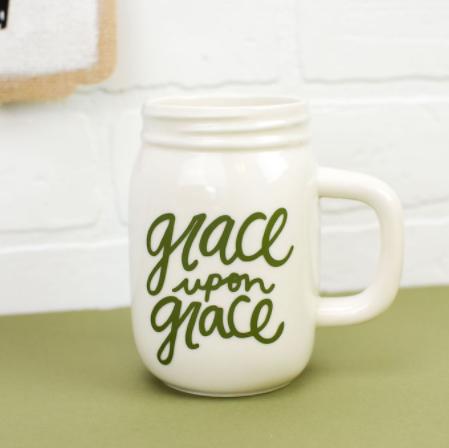 Mason Jar Mug with Vinyl Decal saying Grace upon Grace on it