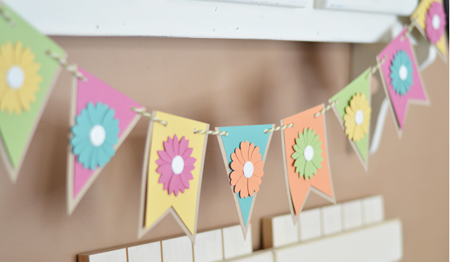 Simple Spring Banner with a variety of shapes and colors and spring flowers added to each shape