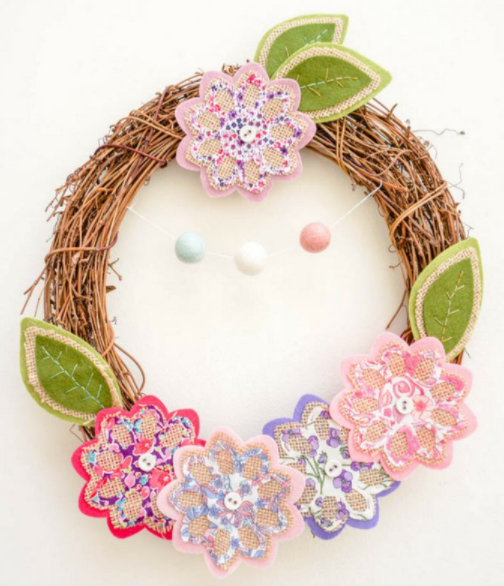Grapevine wreath with spring flowers and leaves cut by die cutting machine added