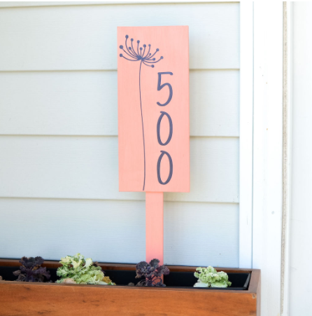 Address plaque on a stake to place in a planter box and display house numbers. Dandelion flower design on it.