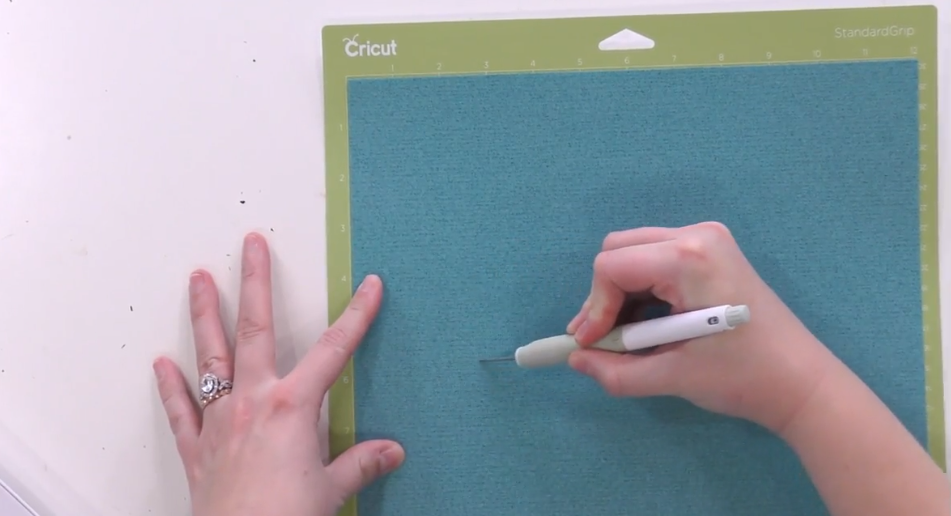 Use The Cricut True Control Knife To Trim Off The Excess Vinyl