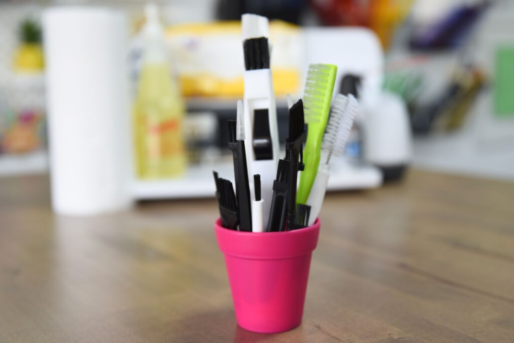 tool kit we recommend for cleaning a cricut machine, various brushes