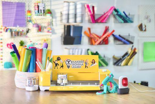 a Cricut machine with a Lynn Lilly glue gun, EasyPress Mini, Cricut Tools, rolls of vinyl