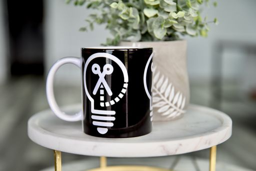 finished mug made with Cricut Mug Press and Infusible Ink with design of Makers Gonna Learn logo
