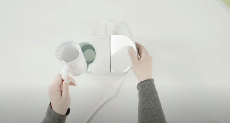 Inserting Mug Into Mug Press