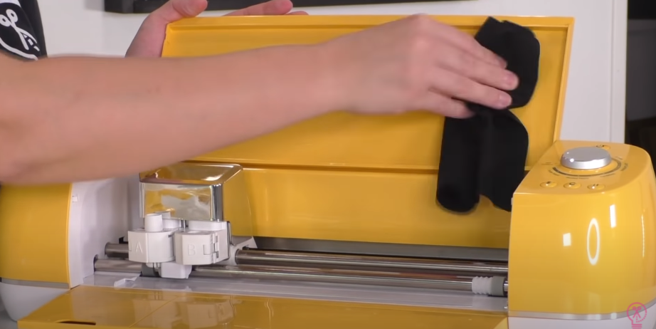 Wiping Off Cricut With Microfiber Cloth