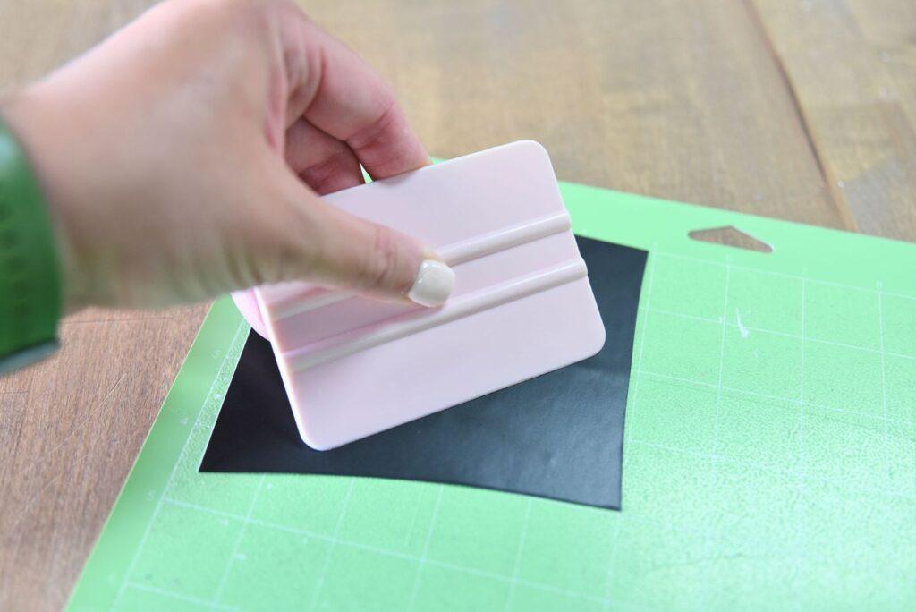 burnishing vinyl onto the cutting mat