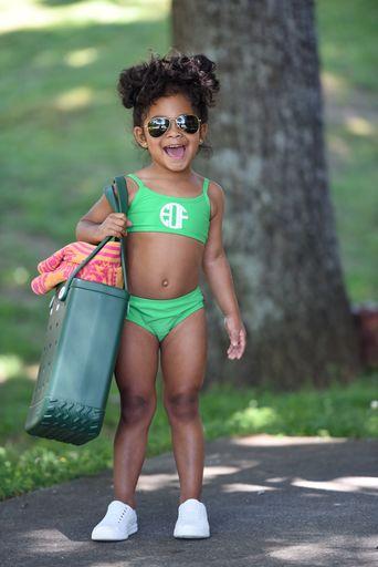 little girl wearing green bikini with monogram on bikini top applied with Cricut Sportflex Iron On Vinyl