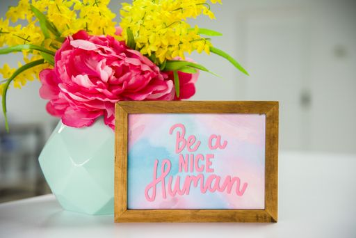 Be A Nice Human Cut File Placed On A Frame